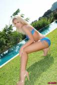 Charlotte-Markham-Blue-And-Purple-Bikini-By-The-Pool-w6vqslh4ry.jpg